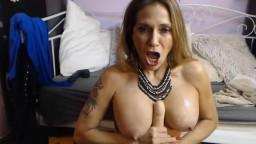Bosomy pornstar Domina Melissa Johnson makes deep gagging