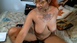 Hot tatted Stella Luna in sexy glasses gets a real climax