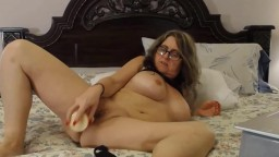 Naughty housewife Lady Bri in glasses with a pretty pussy