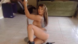 Flexible girl Layla in leather boots does hot striptease
