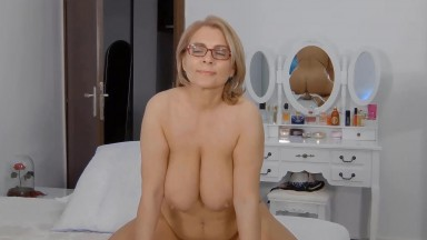Buxomy playful MILF Eilleen is open to trying new things