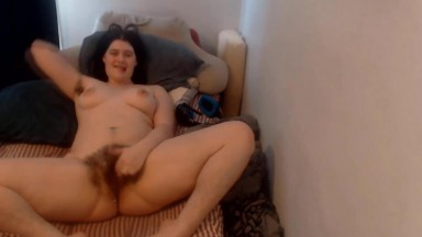 Moaning brunette Jade Forrest fingers her a hairy pussy