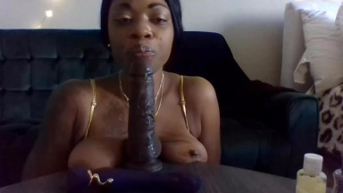 Black mistress with hot body sucking big dildo & squirting